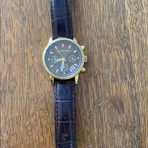 Michael Kors gold watch embossed leather strap